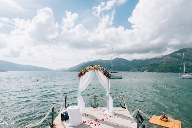 Wedding arch on the beach in montenegro panoramic views