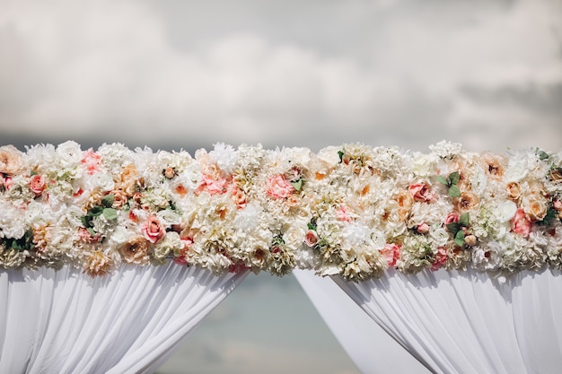 Wedding arch decorated with roses