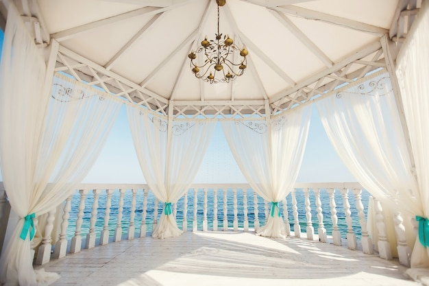 Wedding arch in tiffany color on the beach.