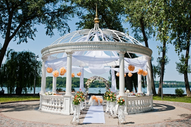 Wedding arch with chairs and many flowers and decor