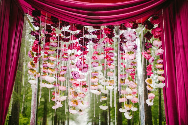 Wedding arch with petals of flowers