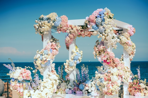 Wedding archway with a lot of different flowers