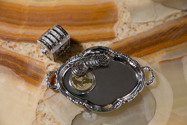 Wedding arras on silver plate