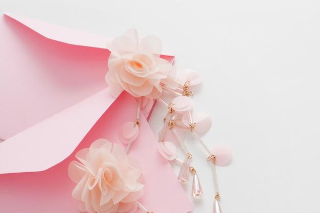 Wedding background decorated pink invitation envelopes