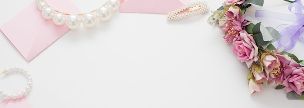 Wedding background decorated with pink invitation envelopes