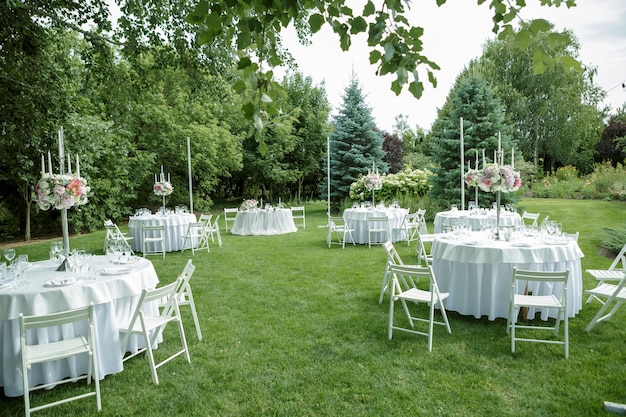 Wedding banquet in the open air, wedding decor on the tables of guests