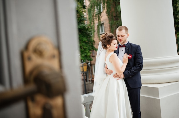 Wedding of beautiful couple. romantic bride and groom standing near white castle