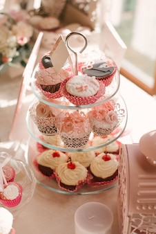 Wedding beautiful cupcakes at candy bar in pink