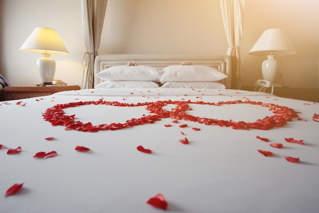 Wedding bed topped with rose petals.thai style wedding tradition
