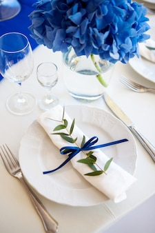 Wedding blue decorations on the table and lavender