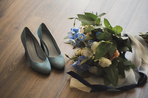 Wedding bouquet and bride shoes.