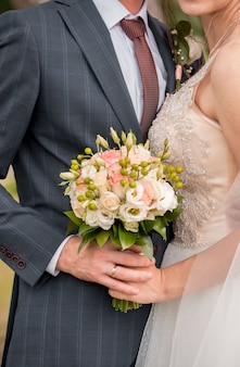 Wedding bouquet of the bride. wedding day. happy bride. the bride's bouquet. beautiful bouquet of white flowers. beautiful flowers.