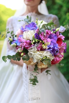 Wedding bouquet of flowers including red hypericum¡