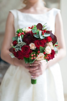 Wedding bouquet of flowers including red hypericum
