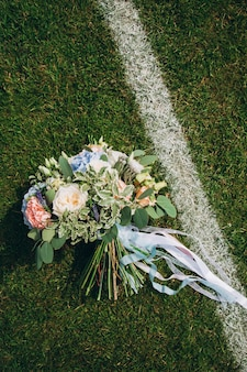 Wedding bouquet on the football field