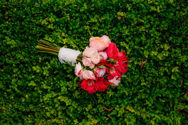 Wedding bouquet on a green background