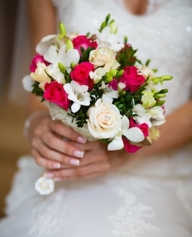 Wedding bouquet in the hands of bride