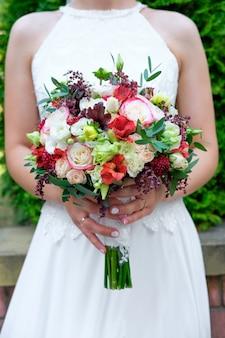 Wedding bouquet on hands