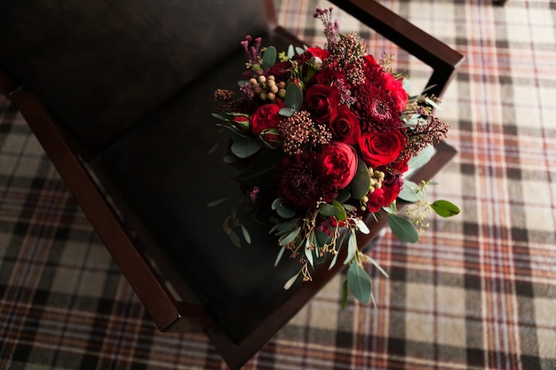 Wedding bouquet on a luxurious leather chair.