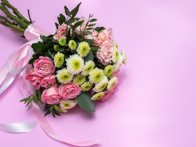 Wedding bouquet on a pink background. copy space.