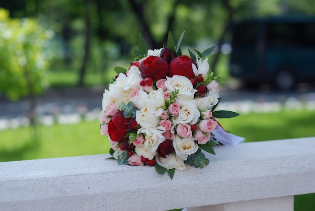 Wedding bouquet. red and pink roses. peony flowers.