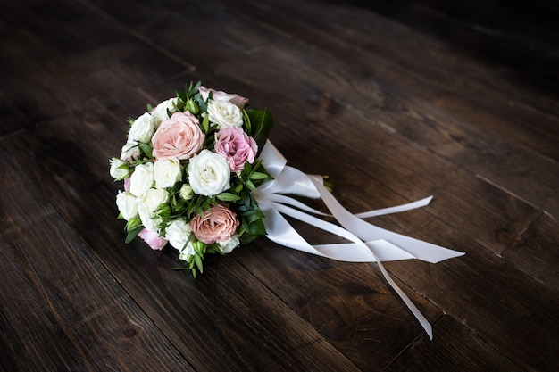 Wedding bouquet of roses on a wooden  closeup