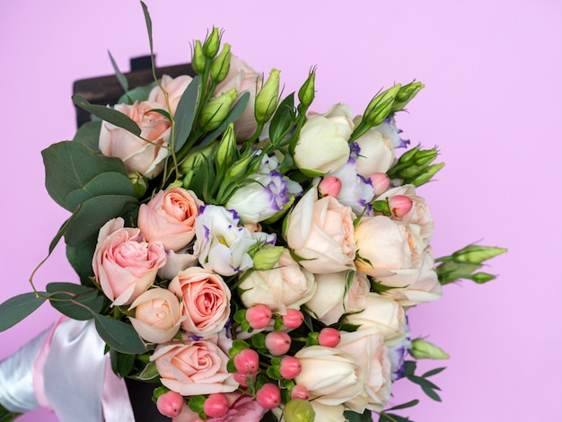Wedding bouquet of soft pink bush roses close-up, beautiful bouquet of the bride.