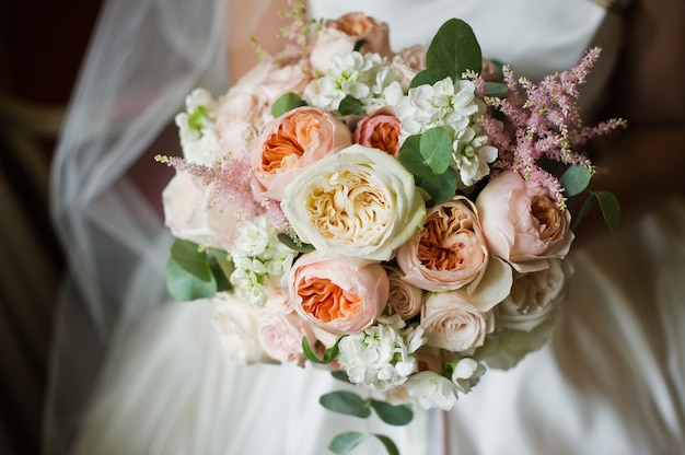 Wedding bouquet of white and pink peonies.