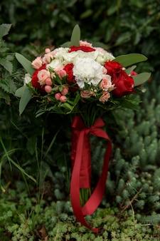 Wedding bouquet with marsala flowers