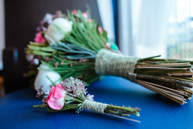 Wedding bouquet with pink flowers and buttonhole