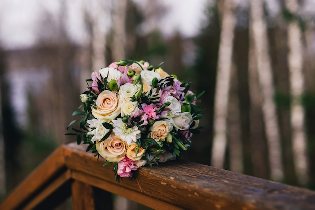 Wedding bouquet with yellow roses, white chrysanthemums and pink alstroemeria