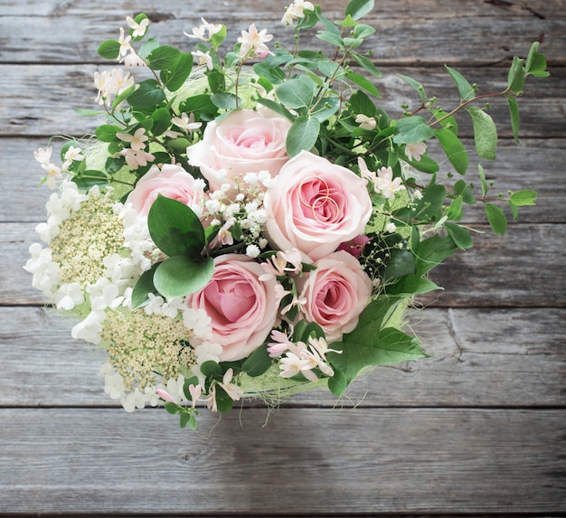 Wedding bouquet on wooden surface