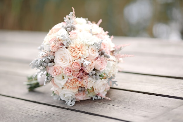 Wedding bouquet on wooden table