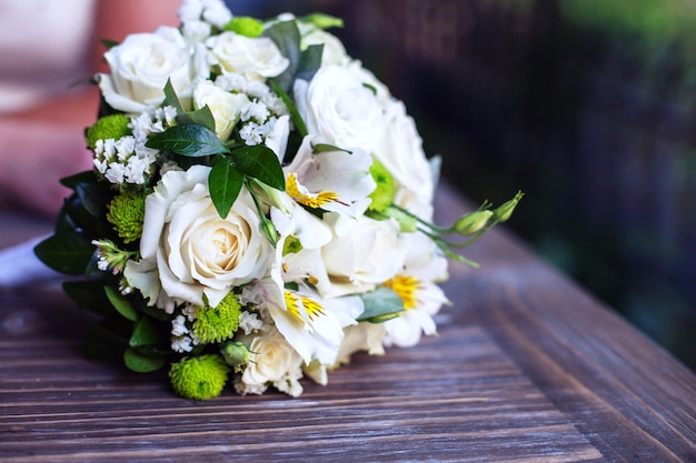 Wedding bouquet wooden table.