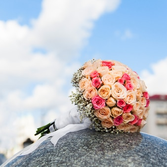 Wedding bouquet of yellow and pink roses