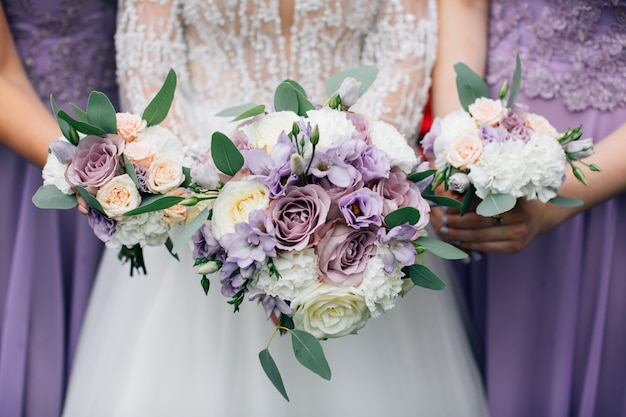 Wedding bouquets in the hands of the bride and bridesmaids