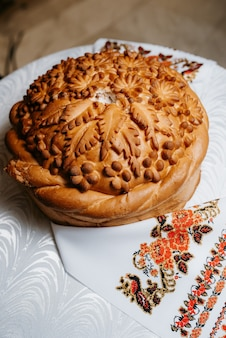 Wedding bread loaf with voluminous twisted pigtails and decorations