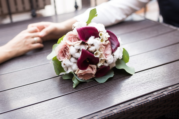 Wedding bridal bouquet on wood close-up.