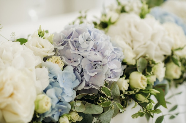 Wedding bride and groom table presidium decorated with a lot of flowers