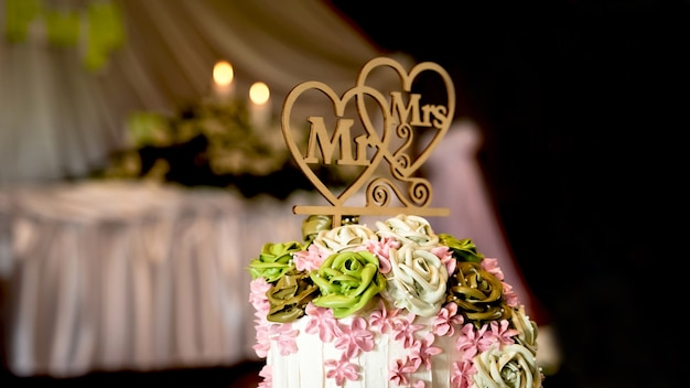 Wedding cake for the bride and groom couple cut in the wedding party event at a restaurant or church.