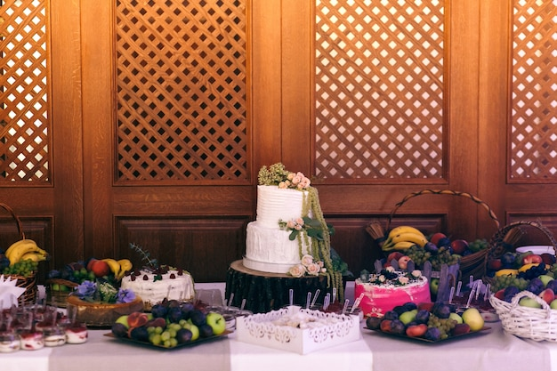 Wedding cake and sweets stand served on block on the buffet