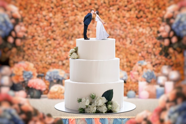 Wedding cake with bride and groom on the top