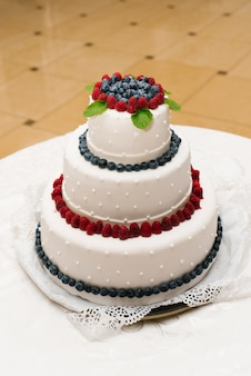 Wedding cake with fresh berries and pearls