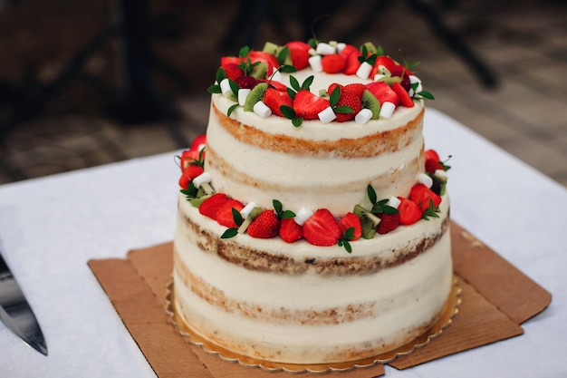 Wedding cake with fresh strawberries