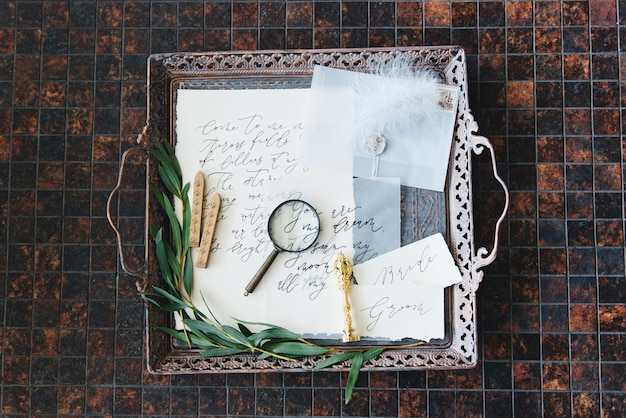 Wedding calligraphy and decor.inspiration. wedding invitations, envelope, cards, printing, magnifying glass, rings. selective focus
