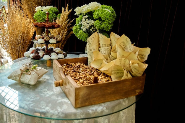 Wedding candy and nuts on table in rustic style