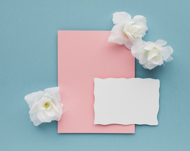 Wedding card with flowers on table