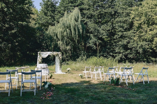 Wedding ceremony decoration, chairs, arches, flowers and various decor