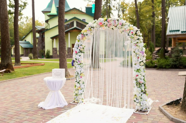 Wedding ceremony decoration. white arch with flowers concept. closeup.