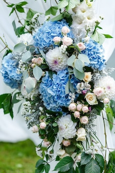 Wedding ceremony decorations arch decorated a lot of flowers in white and blue style